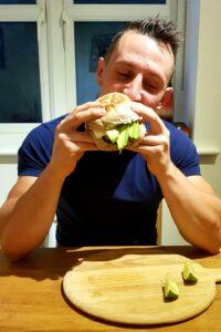Josh eating his healthy burger