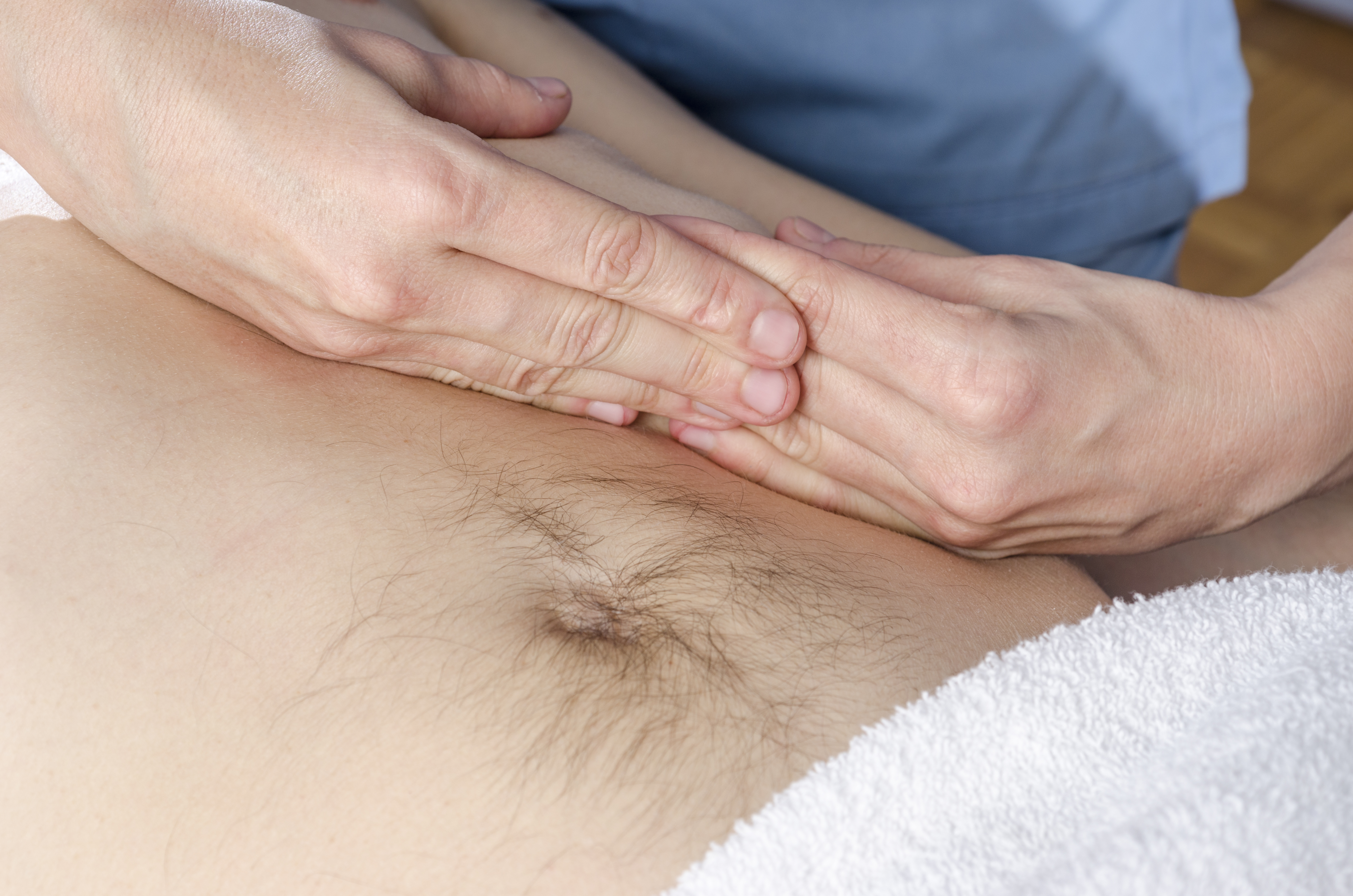 Physiotherapist is doing an activation of the diaphragm. Massage